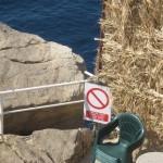 Warning signs at Buža